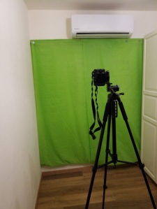 Green screen and a camera in a typical green room setup