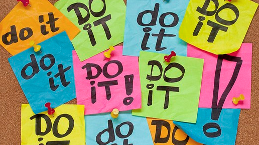 "Cork Board with multiple post-it notes saying ""Do it!"""