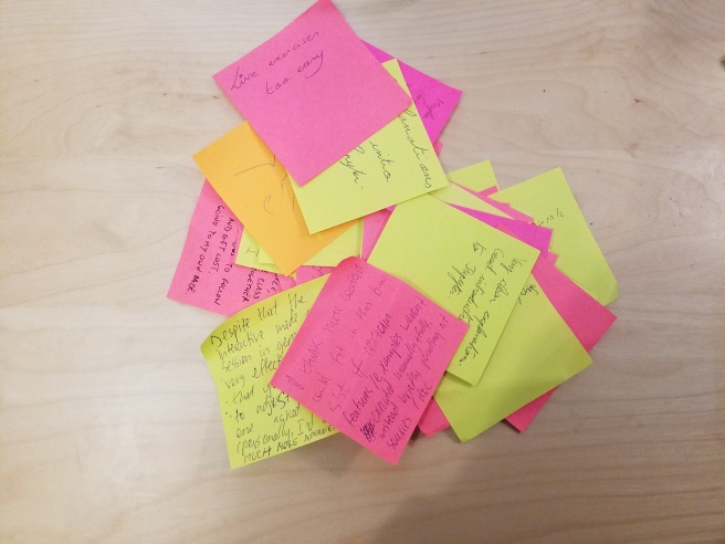 A pile of green and red post-it notes with feedback on them