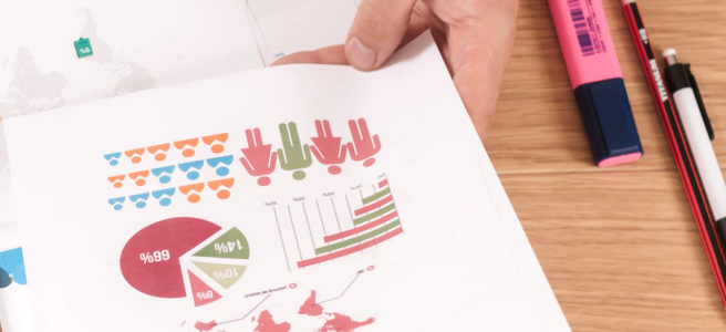 Illustration: a paper sheet with graphs in someone's hand