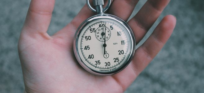 Illustration: a mechanical stopwatch in a person's palm