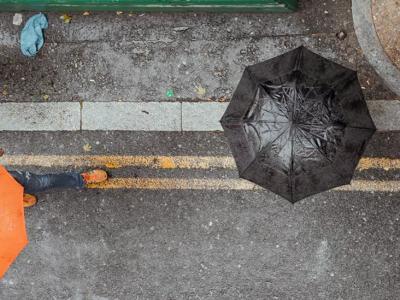 Illustration: photo of people under umbrellas