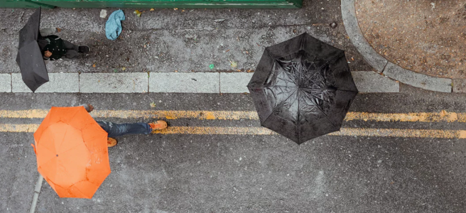 Illustration: photo of people under umbrellas